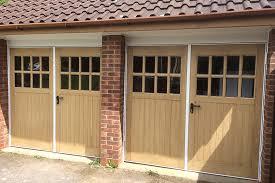 pair of timber side hinged garage doors