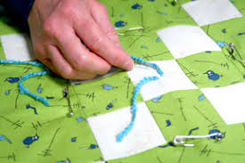 How to Tie a Quilt Tutorial - Quilting Tutorial from ... & Don't tie the knot yet! We like to reinforce this step with one more  stitch. So repeat the needle going through all three layers, keeping the  needle very ... Adamdwight.com