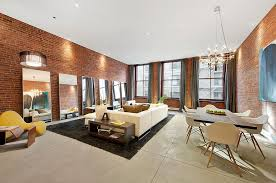 view in gallery inventive use of mirrors in the living room design interior marketing group the exposed brick wall
