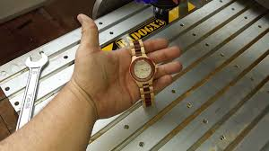 watch made with a badog cnc machine for a wooden watch company