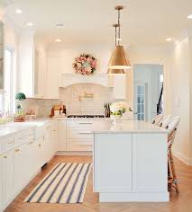 anyway since i have rugs on the brain right now i thought i would share with you the trend of using decorative rugs in the kitchen