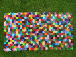 coloured squares of 3 x 3 latch hook knots makes a fabulous bright little rug