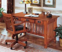 home office with mission style furniture including desk with three drawers and wooden chair with wheels