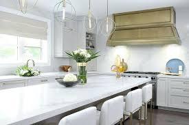 long island quartz countertops gold wood kitchen hood with quartz slab kitchenaid food processor