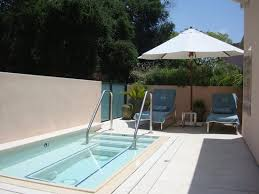 hotel bel air suite private jacuzzi and lounge chairs