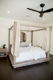 wood canopy bed. Delighful Bed Bedroom Minimalist Master Bedroom With Unfinished Wood Canopy Bedding  Minimalist Bedroom Unfinished Wood Canopy Bed White Bedding Hard Flooring  For Bed
