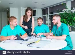 Group Health Doctors Note Group Of Happy Doctors Or Interns With Mentor Meeting And