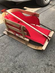 new child sled w cushion wooden pending pickup