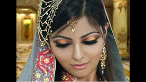 gold and peach mehndi makeup tutorial indian bridal asian arabic gold and green smokey eye