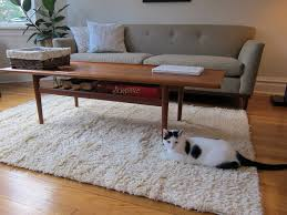rug under coffee table. living room large-size vintage wooden coffee table with storage set on beige ikea shag rug under
