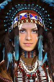 native indian face in hole native costume and war bonnet