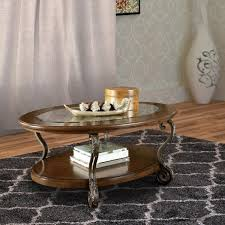 l brown wooden oval cocktail table