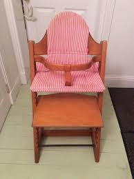 stokke tripp trapp high chair with cushion pads and wooden piece to convert to normal chair