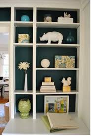 Back painted bookshelves are always an unexpected surprise and they make  all the difference! This