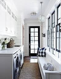view in gallery laundry room with black door and window trim