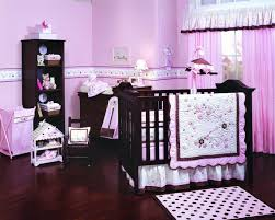 fancy girls bedroom with pink theme also parquet flooring and pink baby bedding on dark brown wooden baby crib also white shade table lamp for your