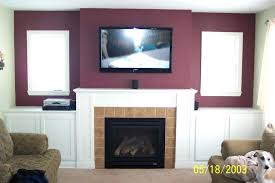 mounting a tv over a fireplace bedroom wall mount over fireplace ideas selection above yes or no luxury how should i run wiring for my height mantle images