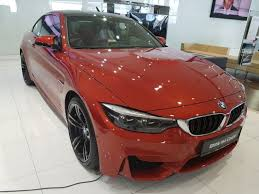 2018 bmw orange. brilliant orange and just beside it was a 2018 sakhir orange m4 coupe but without the  competition package with bmw orange