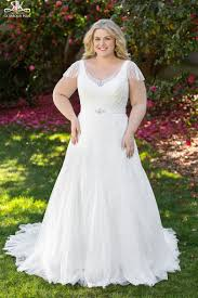 these 8 plus size wedding gown designers are perfect for body positive brides photos