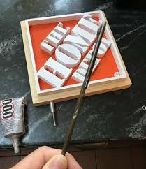 steel dowel glued into trophy