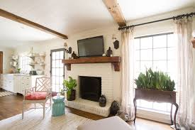 barn beam mantel family room traditional with tv above fireplace rustic wood side table