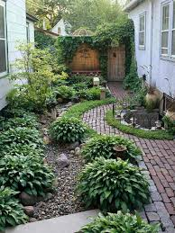 simple landscaping ideas. Narrow Side Yard House Design With Simple Landscaping Ideas And Garden No Grass Trees Herb Plants Beside Brick Walkway Small Half Round Ponds