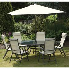 round garden dining table 6 seater chairs and parasol