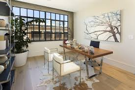home office rug placement. innovative animal skin rugs in home office contemporary with faux rug next to warehouse windows placement