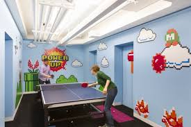 office game room. employees voted on everything from meeting room names to game themes and then designed them rooms the 20th floor are named after office