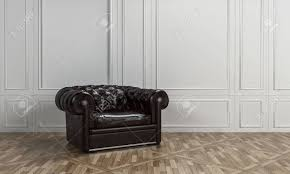 large black leather armchair with on back in a classical living room interior with white wood