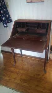 i have a wooden flat front fold down secretary writing desk with the stamp mcg no 1080 on the back what does that mean what is it worth