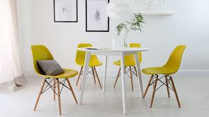 modern 4 seater eames yellow dining set