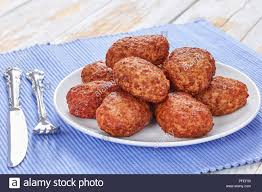 Juicy Delicious Fried Meat Cutlets On White Platter On Kitchen Table
