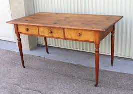 This early 19th century New England farm table shows an exceptional  original surface with outstanding patina