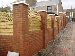 Small Picture Garden wall with brick pillars and decorative wooden fencing