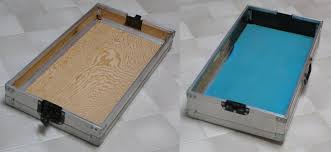 the inside dimensions of each case half are 13 5 x 26 5 inches two panels of 1 8th inch aluminum plate were cut to this size and mounted into the case