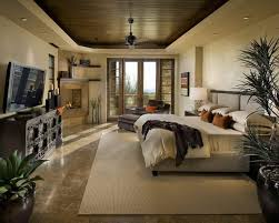 classy home furniture. Hunky Bedroom With Classy Home Decor Of Large Bed Face To The LED TV Also Dressers Plus Fireplace Plants On Big Pots Furniture O