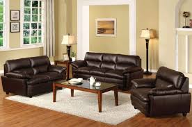 comfortable dark brown leather sofa with classic rectangle coffee table also classic floor lamps and cute white area rug