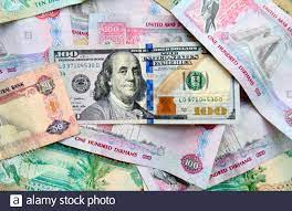 US dollar banknote on top of UAE national currency, top view of mixed dirham  banknotes. UAE paper money. Dirhams and US dollars exchange rate Stock  Photo - Alamy