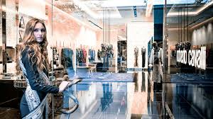 a model walks the roberto cavalli in one of the designer s dresses