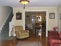 enchanting classic pendant ceiling lamp colorful area rug maroon sofa beside fl pattern armchair laminate wood flooring home living room best