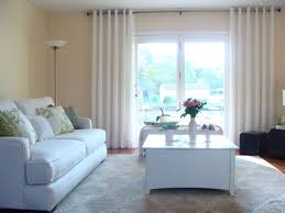 living room living room window treatments with white table and white sofa and cushion and