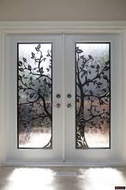double steel door in factory white finish with modern lasercut metal door inserts