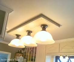 fluorescent kitchen light fixtures replace fluorescent light fixture with incandescent