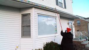 How To Fasten Christmas Lights To House Can You Hang Christmas Lights Without A Ladder With This