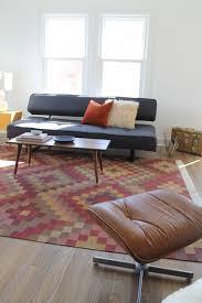 kilim rug and mid century modern vintage coffee tablemodern living room los angeles