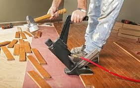 carpenter laying a wooden floor