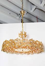 spectacular jewel like midcentury chandelier with hundreds of crystals set in gold plated brass