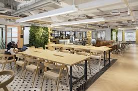 office space architecture. A Made-to-measure Brown Leather Sofa Near To Coffee Counter Attracts Workers Take Break, Cozying Up As If They Are At The Lounge. Office Space Architecture