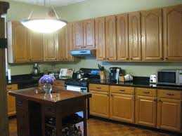 paint color with golden oak cabinets. home improvement, kitchen paint colors with oak cabinets: choosing the right color for country- style kitchen: natural green golden cabinets